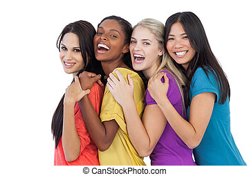 Diverse young women laughing at camera and embracing on white background