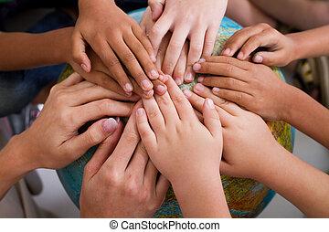 diversity kids hands together