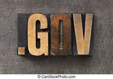 dot gov - internet domain for government in vintage wooden letterpress printing blocks on a grunge metal sheet