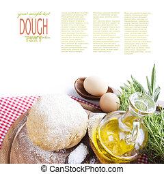 Fresh dough balls with egg, olive oil, fresh herbs and salt.