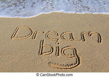 Dream big written in the sand