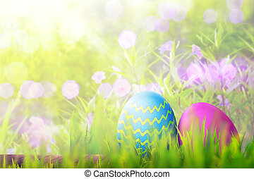 Easter eggs on wooden plank covering with green grass