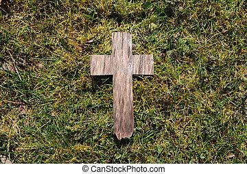 Easter wooden cross on grass