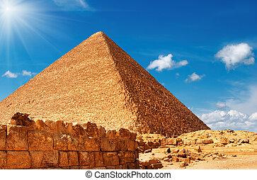 Egyptian pyramid against blue sky