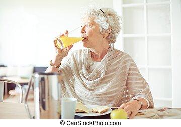 Elderly Woman Drinking Juice