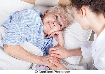 Elderly woman in bed