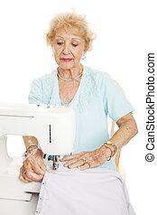 Elderly Woman Sewing