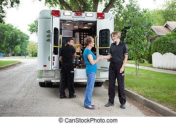 Elderly Woman with Ambulance Staff