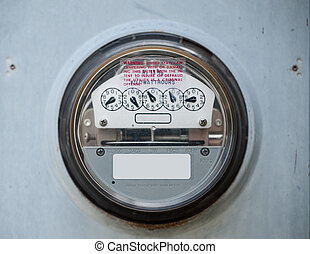 Closeup of a scratched up electric meter in use