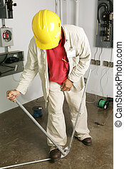 Electrician Bends Pipe