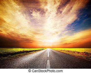 Empty asphalt road. Sunset Sky