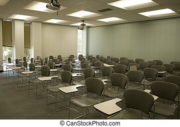 Empty chairs in classroom.
