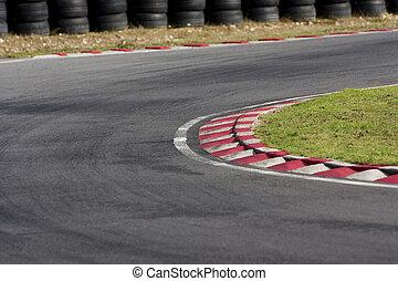 An empty bend on a race car circuit.