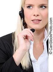 fair-haired woman with earphones