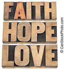 faith, hope and love - a collage of isolated words in vintage letterpress wood type
