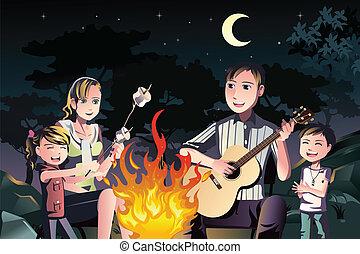 Family having a bonfire