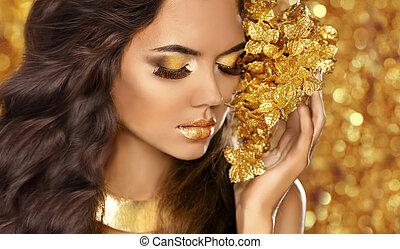 Fashion Beauty Girl Portrait. Eyes makeup. Golden jewelry. Attra
