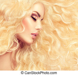 Fashion blond girl with healthy long wavy hair