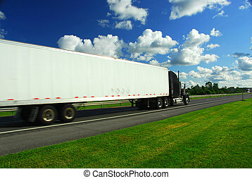 Fast moving truck on highway, blurred because of motion