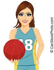 female basketball player holding ball