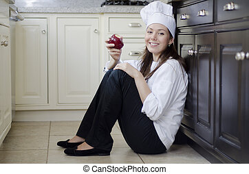 Female chef eating healthy