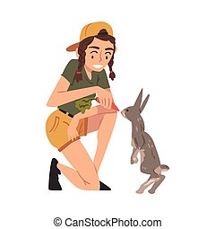 Female Worker Feeding Rabbit with Fresh Carrot, Veterinarian or Professional Zookeeper Character Caring of Wild Animals in Cartoon Vector Illustration