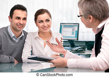 Cheerful young couple at financial planning consultation