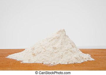 White wheat flour on a wooden table