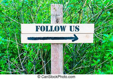FOLLOW US Directional sign