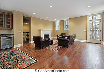 Family room in new construction home with cherry wood floors