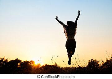 Freedom, beautiful girl jumping