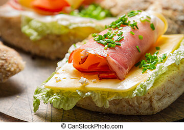 Fresh sandwich with lettuce, cheese and ham
