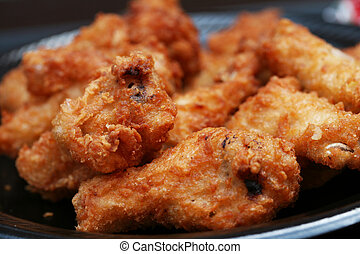 Plate of fried chicken wing dings