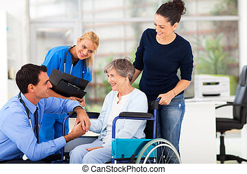 male doctor comforting senior patient