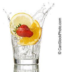 splashing orange, lemon and strawberry into a water glass