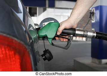 car fueling up