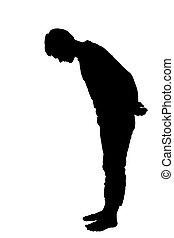 Full length side profile portrait silhouette of a teenage boy looking down