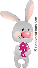 Funny rabbit with egg