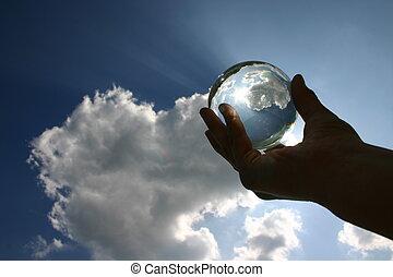 a glas ball against the sky
