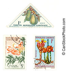 Obsolete postage stamps from Gabon (Africa). Old collectible items - leisure and hobby collection. These post stamps show fruit, flowers and flora.