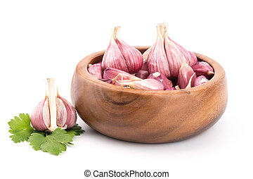 Garlic on wooden bowl