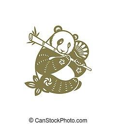 Giant panda eating bamboo paper-cut