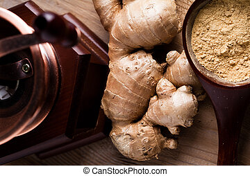 Ginger root and spice closeup on wooden table