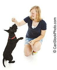 Girl and Dog Do Tricks