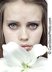 girl behind a snow-white lily