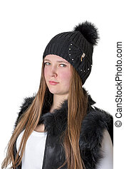 girl in a hat with a serious look