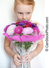 Girl with a bouquet in hands