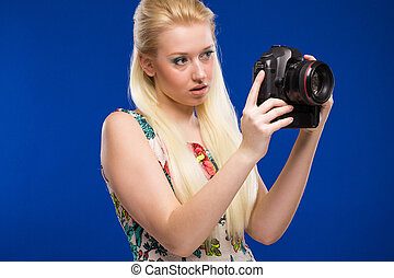 Girl with a camera in hand