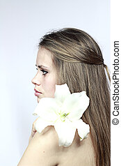 girl with a lily looking in a distance