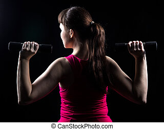 Girl with weights in the hands